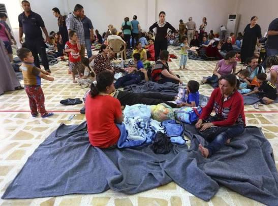 Irak -Reuters- Mosul, familias cristianas que dejaron sus casas