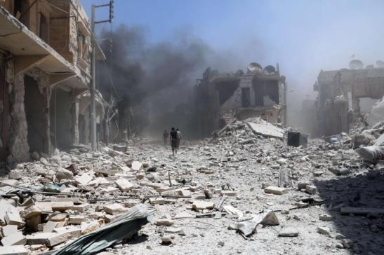 Peace - Rubble covers the street following an alleged airstrike by a Syrian army helicopter in the northern city of Aleppo on June 11
